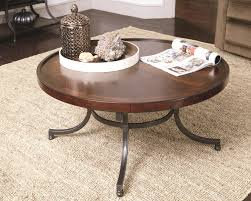 round cocktail table with metal legs by hammary wolf and