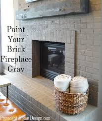 gray painted brick fireplace paint your brick fireplace gray found at providenthomedesign com