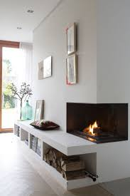Streamlined corner fireplace in a minimalist barn house in Blaricum, The  Netherlands.