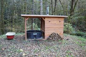 a few years ago i shared a popular post about my friends do it yourself wood fired hot tub since that time doug and erin had a kid and moved to a