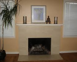interior white wooden fireplace mantels on over grey stone fireplace on cream wall and laminate