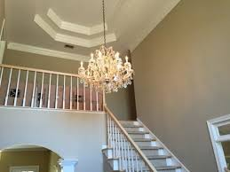 what should the foyer chandelier be replaced with a larger crystal chandelier the existing foyer chandelier is about 2 x 3 thanks for any advice