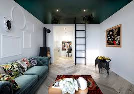 painting this mezzanine premise with stylish and characteristic wall accents that visually separates the premises creates the feeling that the bed area is a