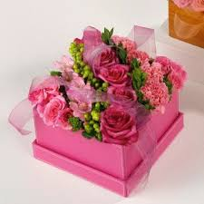 Pretty pink flowers in a square pink box, finished off with organza ribbon.  Great