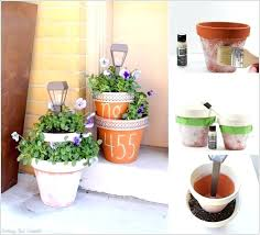 diy lamp posts add solar lamp posts to tiered planters diy outdoor lamp posts