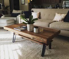 custom made reclaimed wood coffee table with flat iron legs and shelf
