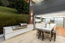 outdoor kitchen cabinets bar area plus metal bar stools stainless steel grill and bbq light brown