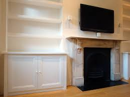 specialists in bespoke bookcases custom built cabinets made to measure shelving floating shelves and fitted wardrobes