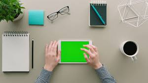 items for office desk. Top View Woman Using Tablet Device With Green Screen At Office. Table Background White Items For Office Desk