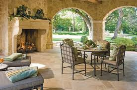 space living room olive: affordable outdoor living space idea with round brown table chairs cream mantel green garden state