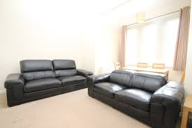 3 and 2 seater genuine black leather sofas in excellent condition
