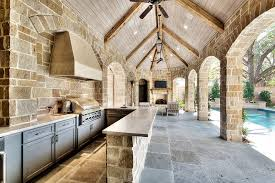 patio outdoor stone kitchen bar:  outdoor kitchen bar patio traditional with range hood exposed beams