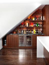 stylish small home wine bar with under stair storage also brick wall also  veneer cabinets