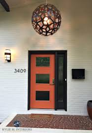 exterior front door mid century style painted orange with dark brown black trim and painted