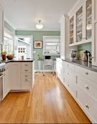 Kitchen paint color, green blue. Glass cabinets to countertop. Dark solid  surface countertop