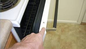 remove the two s that hold the face of the door to the inside panel using a phillips head driver spread maytag door apart