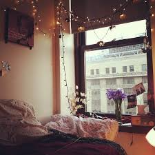 cool dorm lighting. i love this bedroom decorating idea with fairy lights flowers and vintage looking polaroid photos wish my had a good view cool dorm lighting