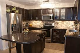 beige wooden laminate countertop antique white kitchen cabinets dark and floors corner