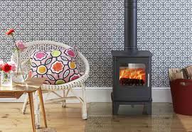 clean lines and contemporary design a free standing multi fuel stove for the smaller room features fire slide control and air wash technology