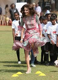 Prince William and Kate Middleton meet Mumbai s slumdog children.
