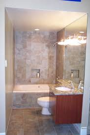 mocha tile bathtub shower combo connected by mocha tile wall and brown wooden floating bathroom vanity