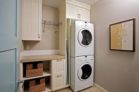 calgary stackable washer dryer laundry room traditional with ...