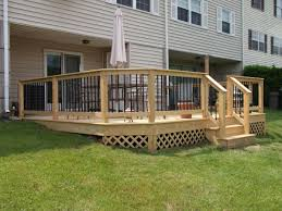 glass barades deck railing decked built lumber dark spindles paint outside groove tongue fencing installer