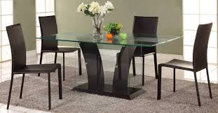four chairs in dining room. dining room table set with glass base and four chairs in
