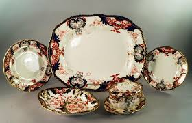 lot 33 of 575 a royal crown derby porcelain part dinner service late 19th century decorated in the imari 3615 pattern comprising large meat platter 49cm
