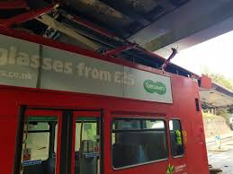 london bus specsavers advert loses its roof in a crash  london bus specsavers advert on the side loses its roof in a crash