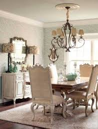 French Country Style Dining Room With Wallpaper And Chandelier And
