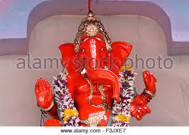 idol of lord ganesh with simple decoration of artificial flowers