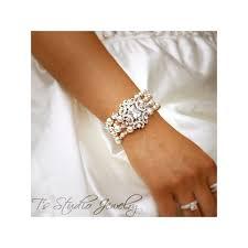pearl and crystal bridal cuff wedding bracelet pearl and crystal bridal chandelier earrings
