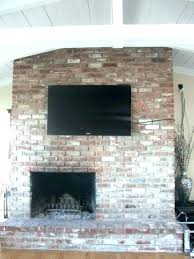 mount tv on brick wall mounted above fireplace hide wires mounting a above fireplace hiding wires