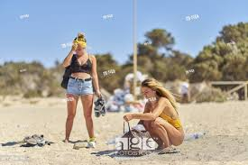 stock photo two young dutch women on vacations ng on the beach dutch ethnicity at holiday destination chrissi island crete greece
