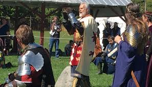 king arthur makes a proclamation to the saxon