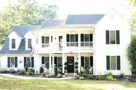 house with black shutters white house black shutters fall porch white house black shutters black door