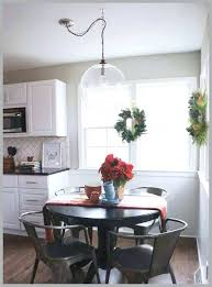 hanging light fixtures over dining table chandelier over dining table dining table swag of post