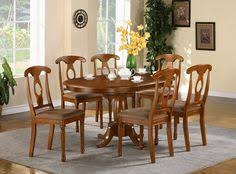 discover the quality and style of the east west furniture portland single pedestal portland oval table set with napoleon upholstered chair