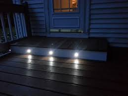 deck floor lighting. fine floor led step lights  frosted 40mm plactic trimmed mini round deck   accent light 05 watt shown installed in customers porch step for floor lighting