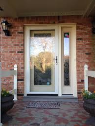 textured fiberglass front entry door with wrought iron decorative glass