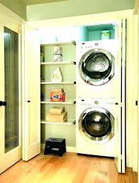 washer and dryer cabinets between storage laundry room info for stacked stackable cabinet closet depth