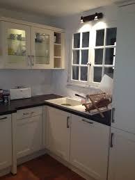 wall light fixture over kitchen sink black kitchen countertop white wall cabinet for kitchen white kitchen