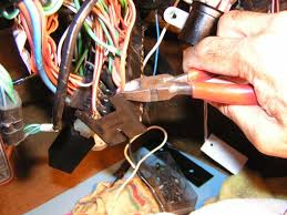 replacing the main fuse box clean and attach the cut wire into the modified spade connector tip crimp to hold the wire in place fold a business card and cut to size that allows you