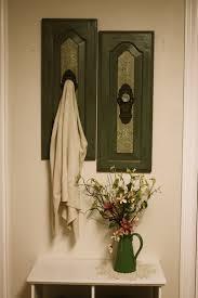 green wall hanging with antique door