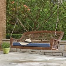 spring haven brown 2 person wicker outdoor swing with blue cushion