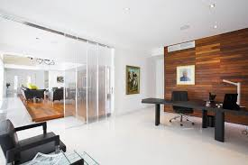Minimalist cool home office Trendy Luxurious Minimalist Home Office Interior With Brown Wooden Wall Paneling And Black Leather Chair Also Glass Wall Divider Secureidmcom Luxurious Minimalist Home Office Interior With Brown Wooden Wall