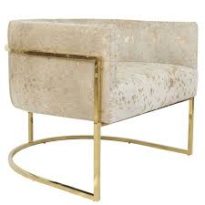 modern style lisbon accent chair in gold speckled cowhide w curved brass frame for