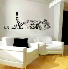 contemporary interior living room decors with black and white vinyl wall decal feat white over size chairs on oak wood floors ideas