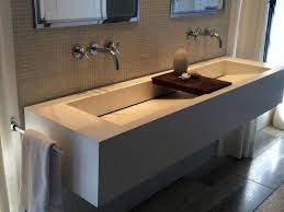 sophisticated white commercial trough sink with wooden soap dish as well as double bathroom wall mirror and stainless towel rails as inspiring mode